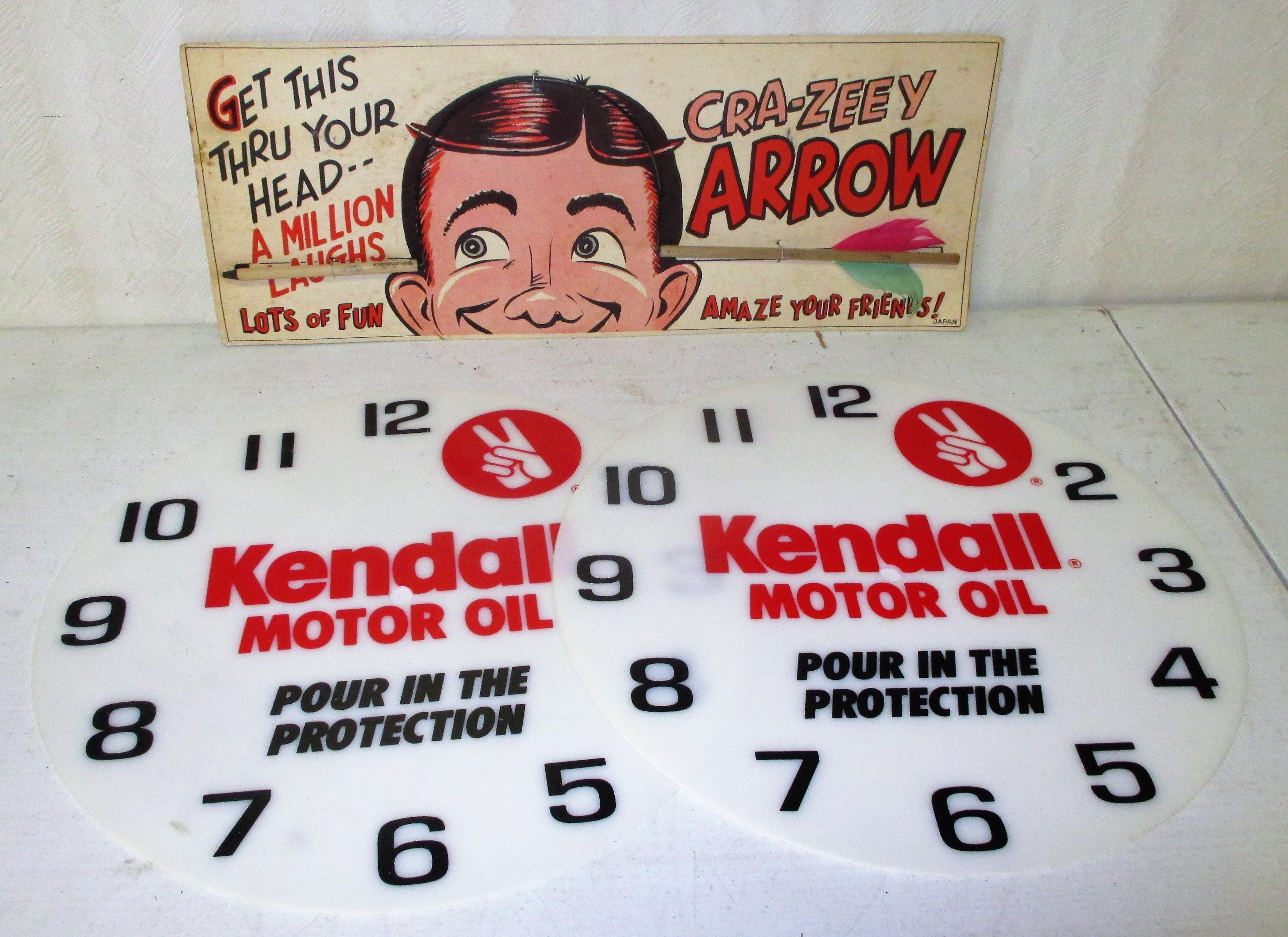 199: Kendall Clock Faces And Arrow Sign