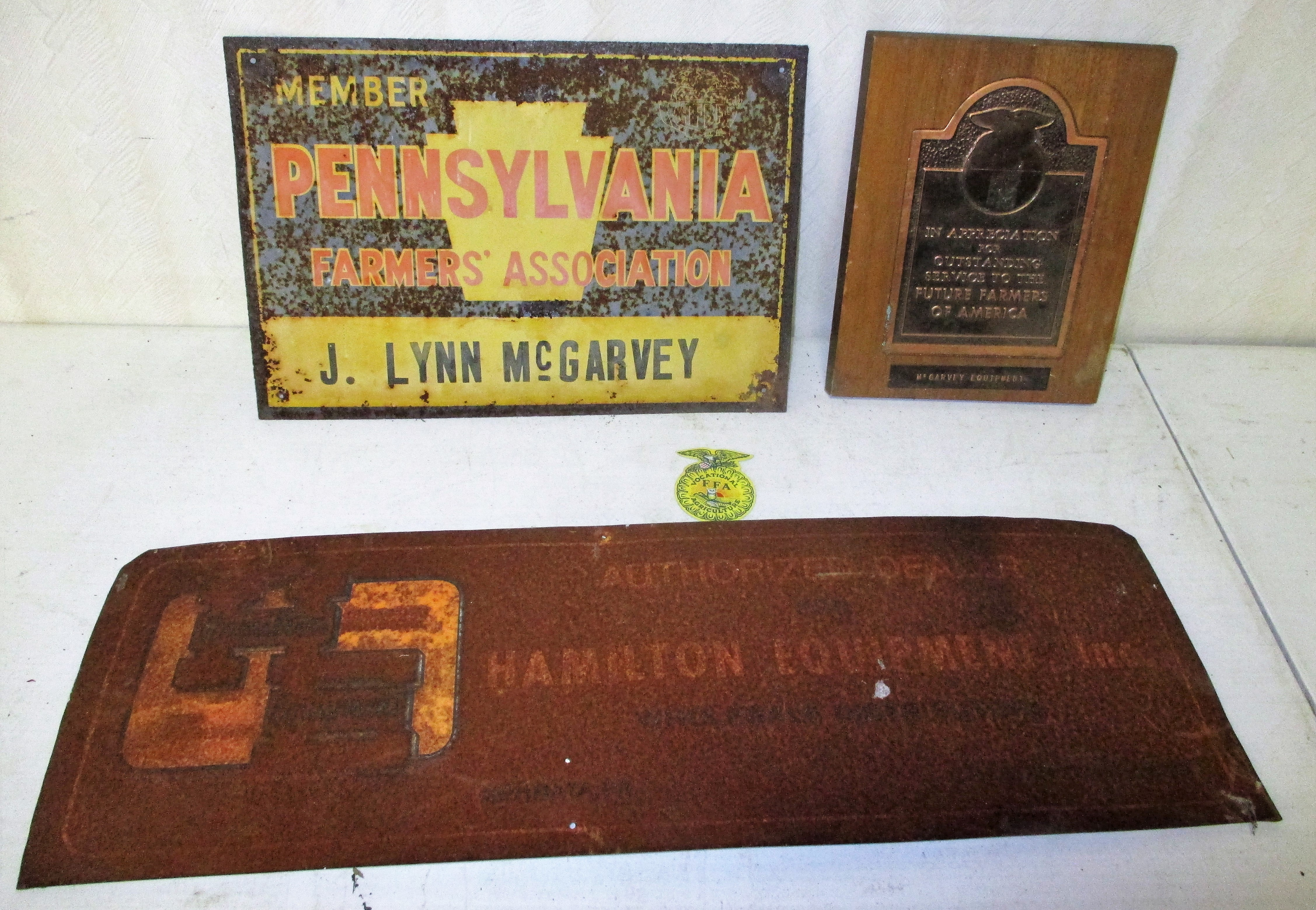 204: McGarvey Equipment Plaque And Farmer's Assoc Sign