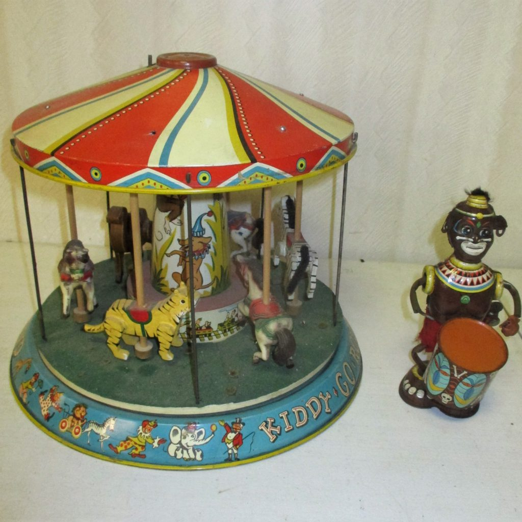 117: Tin Litho Merry-go-round And Monkey