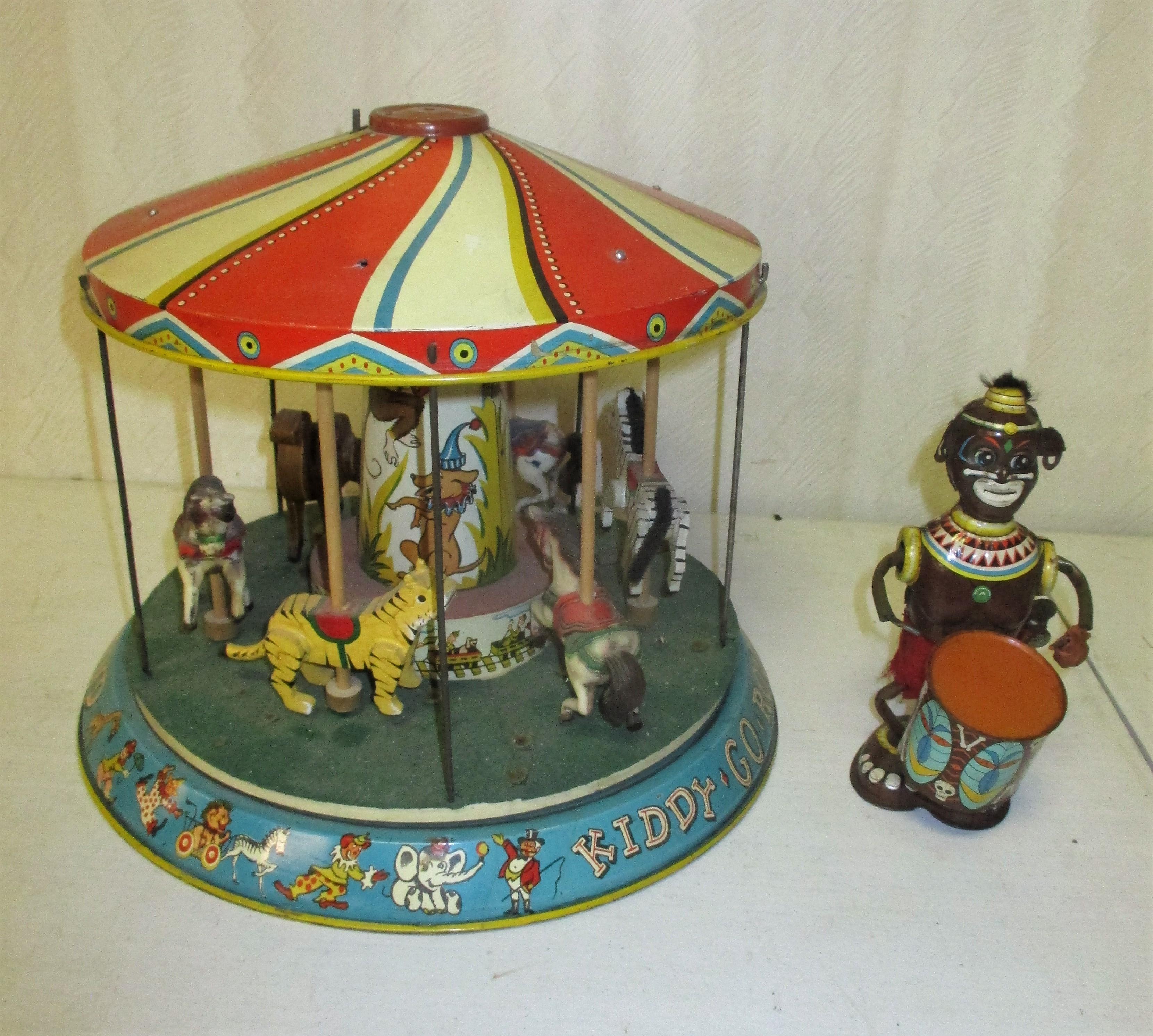 117: Tin Litho Merry-go-round And Monkey