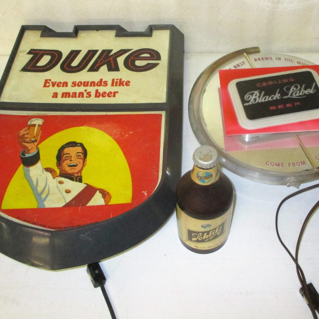 48: Duke And Black Label Signs, Schlitz Coasters