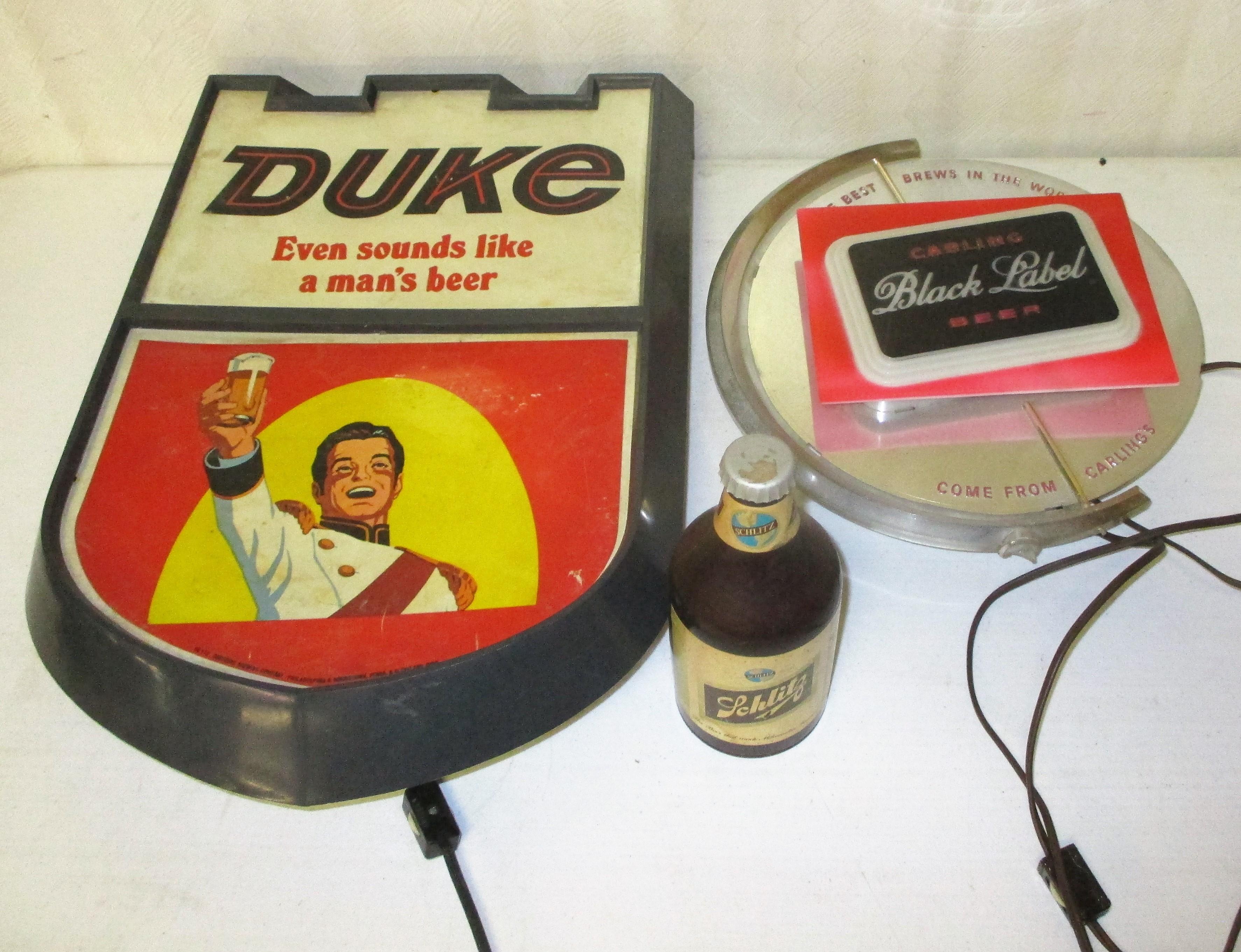 48: Duke And Black Label Signs, Schlitz Coasters