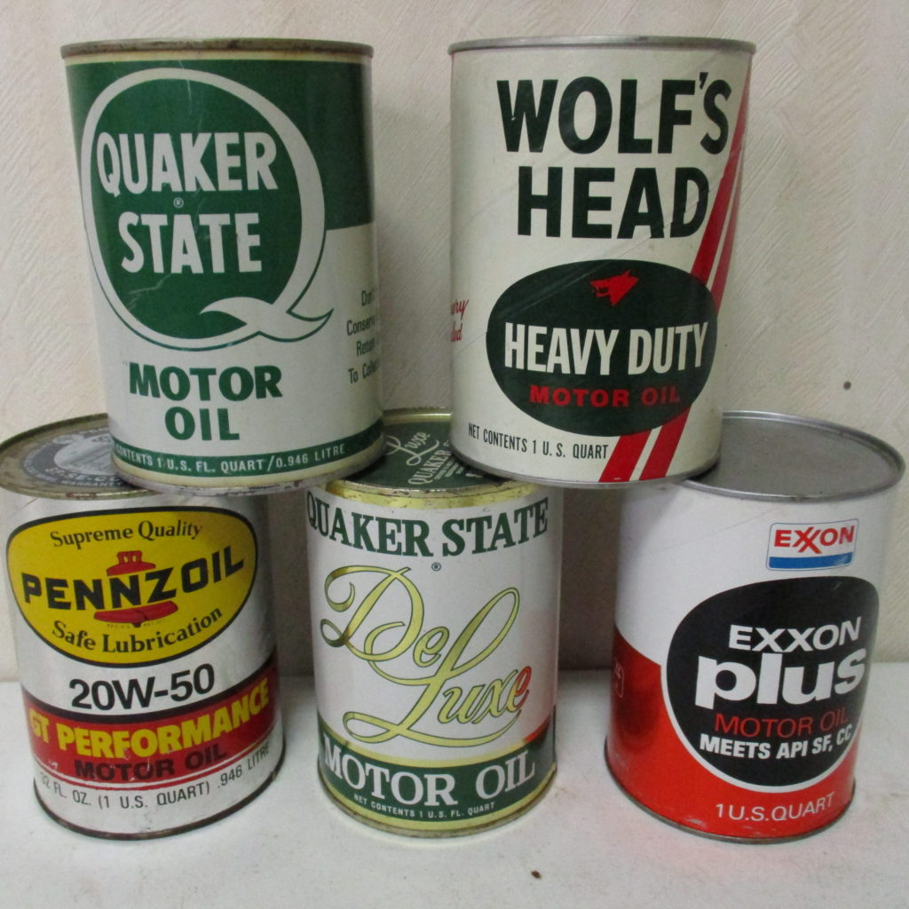 Lot 101: (5) Quart Motor Oil Cans