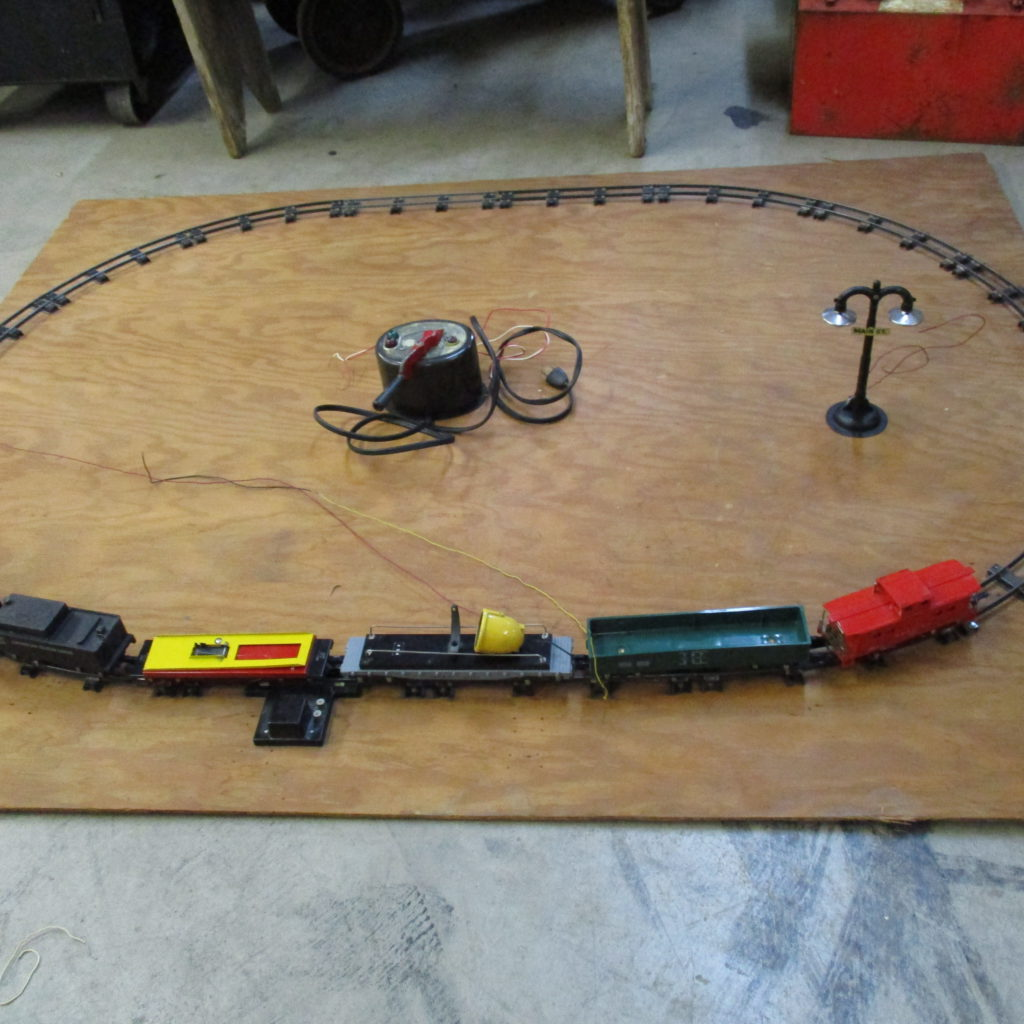 "Lot 196: American Flyer Train Set On Plywood - 48"" X 5'"