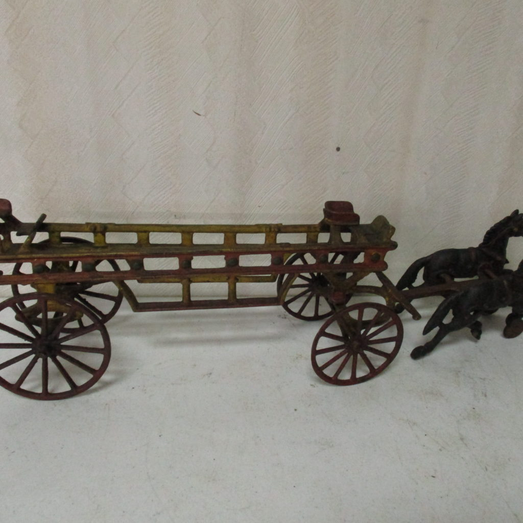 Lot 199: Cast Iron Horse Drawn Firewagon