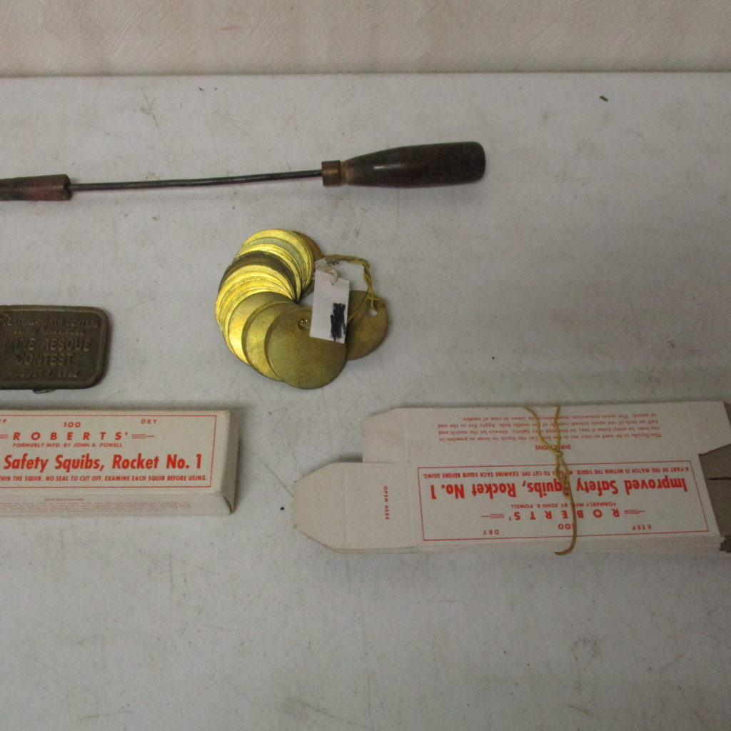 Lot 213: Blank Mining Tags, Belt Buckle, Safety Squibs