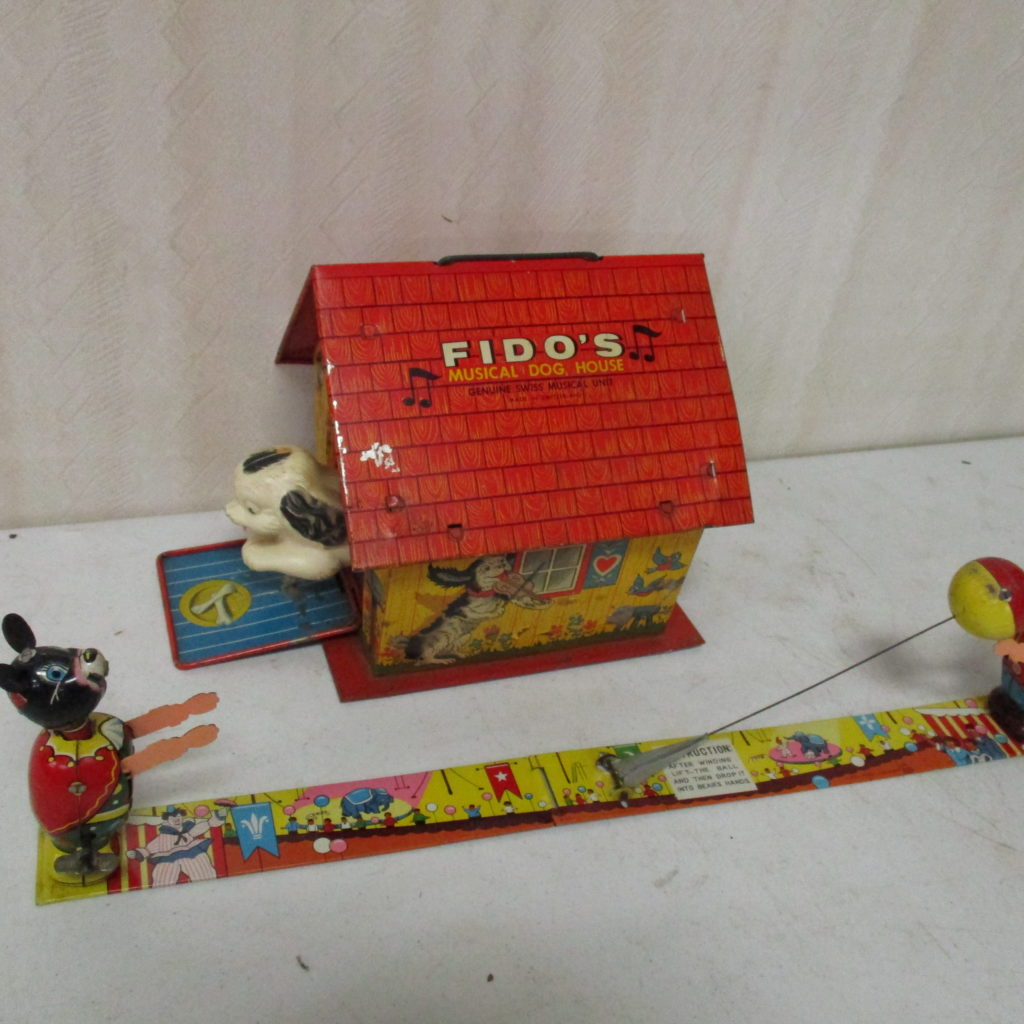 Lot 235: (2) Tin Toys