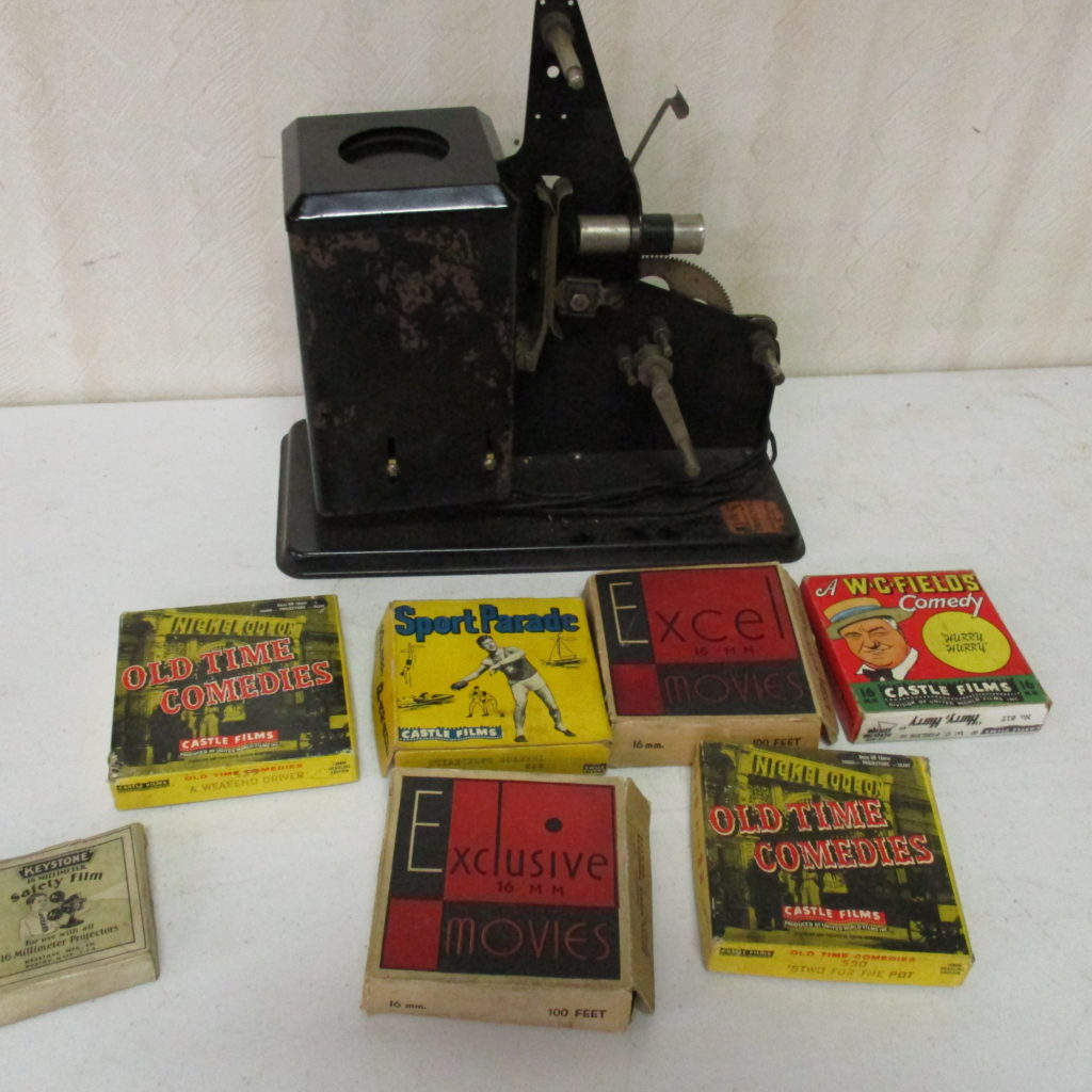 Lot 252: Vintage Film Projector With Film Reels
