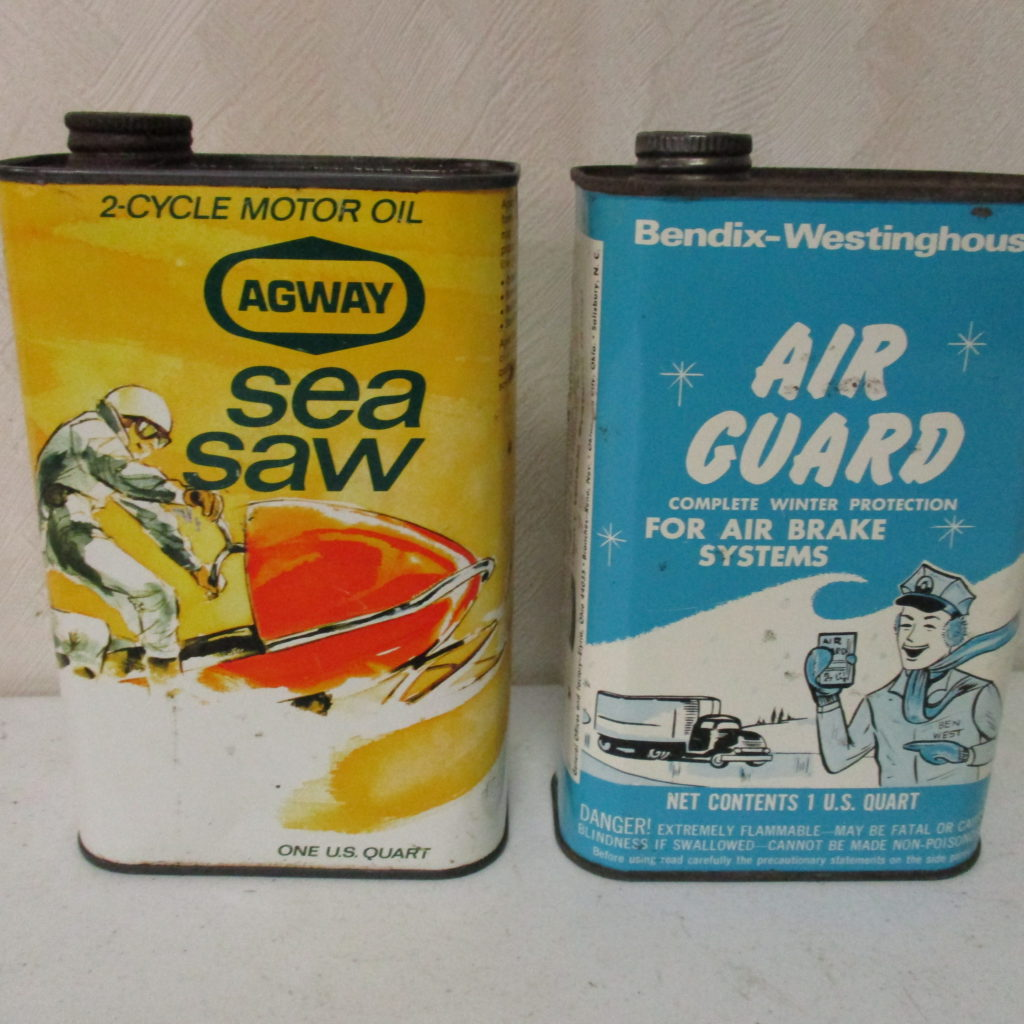 Lot 98: Air Guard And Sea Saw Quart Cans